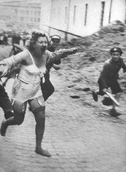 Ashkenazi woman chased by boys with clubs occupied Poland July 1941