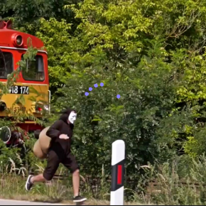 Activist in Snail Costume Outruns Ancient Train