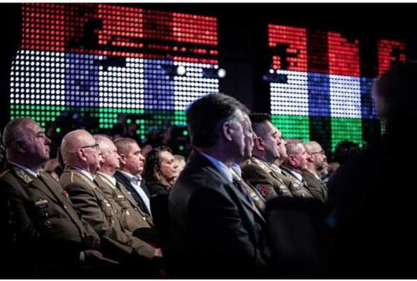 Military leaders attentively listening to Orbán's state of the nation speech at a Fidesz party event Source: Orbán's Facebook